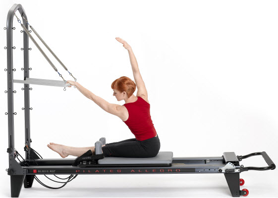 Woman working on Pilates Tower