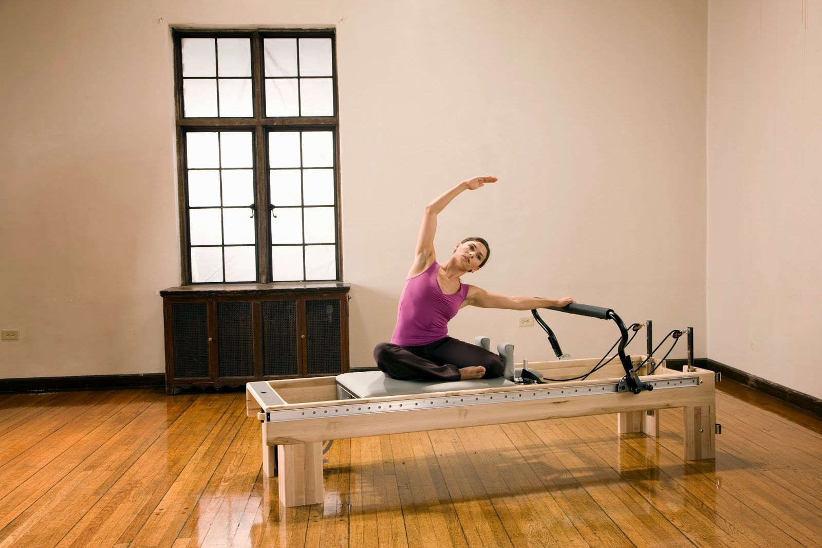Woman on reformer equipment