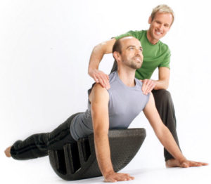 Men doing Pilates exercise